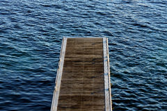 Walking on water. Wooden deck jutting into the sea Stock Photo