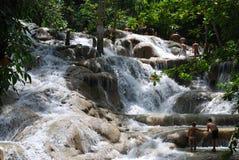 Walking In Waterfalls. Walking inside Dunn's River Fall - a popular attraction in Ocho Rios, Jamaica Royalty Free Stock Image