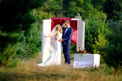 Walking wedding couple in the forest. Bride with veil. selective focus stock images