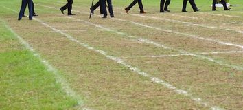 Walking on white lines track. Running on white lines track in football Sports stadium Royalty Free Stock Photography