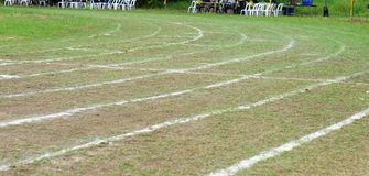 Walking on white lines track. Running on white lines track in football Sports stadium Royalty Free Stock Photos