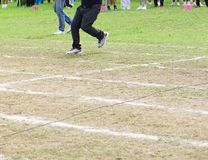 Walking on white lines track. Running on white lines track in football Sports stadium Stock Image
