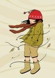 Walking in windy weather. The little girl walking in windy weather Royalty Free Stock Image