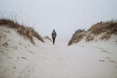 Walking on the winter beach Royalty Free Stock Photo