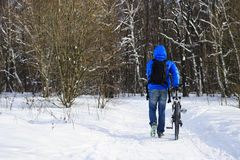 Walking winter cyclist royalty free stock photos