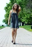 Walking woman. Young beautiful girl walks in outdoor Stock Photography