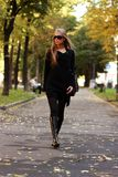 Walking woman. Blonde young woman in Autumn outdoor Royalty Free Stock Image