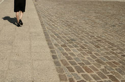 Walking woman. A walking woman and her shadow Stock Photo