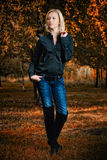 Walking woman in autumn park Stock Image