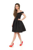 Walking Woman In Black Cocktail Dress ANd High Heels Stock Photography