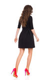 Walking Woman in Black Mini Dress, Rear View Royalty Free Stock Photo