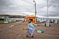 Walking woman close to the habor. Copacabana is the main Bolivia stock photography