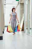 Walking Woman With colored Shopping Bags Royalty Free Stock Images