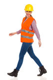 Walking Woman Construction Worker Side View Royalty Free Stock Images
