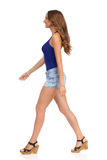 Walking Woman In Cork Heels And Jeans Shorts Royalty Free Stock Image