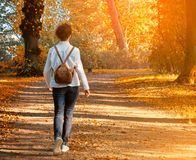 Walking woman on a fall day Stock Photos