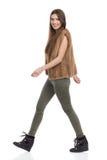 Walking Woman In Fur Waistcoat Looking At Camera Stock Images