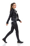 Walking Woman In Leather Clothes Royalty Free Stock Photography