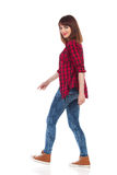 Walking Woman Looking Over The Shoulder Royalty Free Stock Image