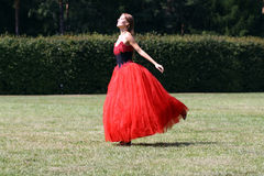 Walking woman in a red gothic dress Stock Images