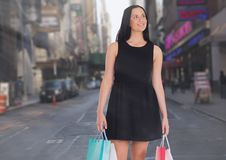 Walking woman with shopping bags in city Stock Photos