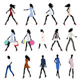 Walking women colored Stock Photography