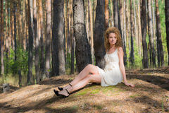 Walking women rests in forest Stock Photo