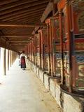 Walking women tibet. Outer tibet and walking praying women in temple Stock Image