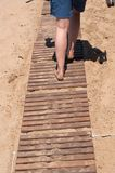 Walking on wooden boardwalk Stock Images
