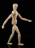 Walking wooden figure Stock Image