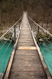 Walking on wooden footbridge crossing over turquoise river of soca, triglav national park, slovenia Royalty Free Stock Images