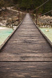 Walking on wooden footbridge crossing over turquoise river of soca, triglav national park, slovenia Royalty Free Stock Photography