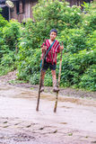 Walking on wooden stilts. Stock Photography