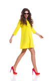 Walking In Yellow Dress Stock Photography