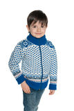 Walking young boy in a sweater Stock Photo