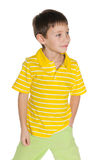 Walking young boy in yellow shirt Stock Image
