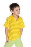 Walking young boy in yellow shirt Stock Image