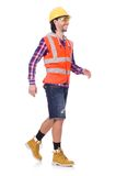 Walking young construction worker isolated on the. Walking young construction worker isolated on white Royalty Free Stock Image