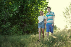 Walking young couple Stock Images