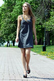 Walking young woman. Young beautiful girl walks in outdoor Royalty Free Stock Photos