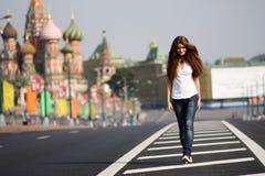 Walking young woman Stock Photos