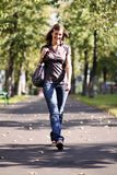 Walking young woman Stock Photos
