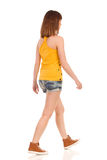 Walking Young Woman Rear Side View Stock Photo