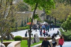 Walking youth in city park, Baku Stock Photo