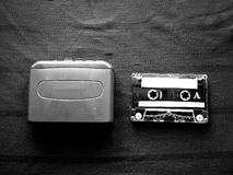 Walkman and cassette in black and white. The original Walkman, released in 1979, was a portable cassette player that changed listening habits by allowing people royalty free stock photos