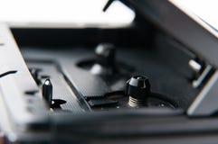 Walkman interior. Old black walkman focus on the inner moving mechanism Stock Photo