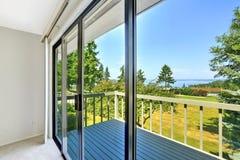 Walkout deck with glass slide door Stock Image