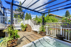 Walkout deck  with jacuzzi and pergola Royalty Free Stock Image