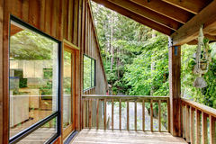 Walkout deck in log cabin house Stock Photography