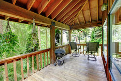 Walkout deck in log cabin house Royalty Free Stock Image